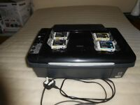 Epson Stylus DX4450 all-in-one printer / scanner / copier with cartridges.