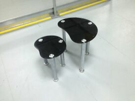 BLACK GLASS AND CHROME OVAL STYLE SHAPE NESTLED TABLES TWO IN TOTAL