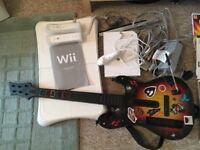 Wii package with guitar hero, games and controllers