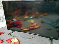 """43"""" 4K UHD SMART WIFI LED SLIM LIGHTWEIGHT TV has free view built in has remote"""