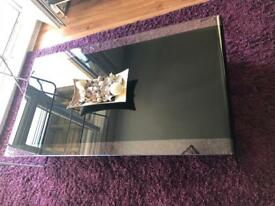 Stunning black glass curved coffee table