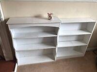 2 white bookshelfs