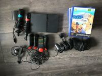 Ps2 Excellent condition with 13 games and a full Singstar and Buzz kit