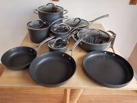 9 Saucepans - 6 with lids by Kirkland Signature - Hard Anodised black heavy-gauge aluminium