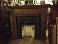 FIREPLACE WITH A WOOD SURROUND AND A TILED INSET