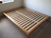 Solid wood double bed frame with mattress from smoke-free home.