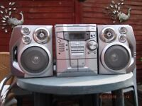 Sharp Music System with radio, cd and tape.