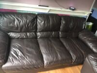 3 and 2 seater brown leather sofas.