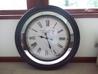 Giant circular wall clock with wooden surround