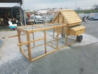 Wooden Hen Arks with pen cage run on wheels. Dog kennels and rabbit hutches