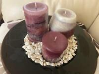 Candle holder with pillar candles and pebbles