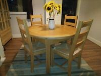 solid oak round extendable table and 6 oak chairs