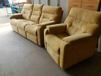 Large beige fabric three seater sofa with reclining armchair