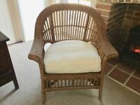 Good quality wicker conservatory chair with cream seat cushion