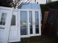 large bundle of upvc doors and french doors complete sale to clear