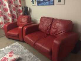 Red leather 2 seater and a chair.
