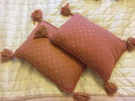 Two small cushions