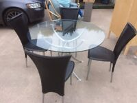 GLASS DINING TABLE AND FOUR LEATHER AND CHROME CHAIRS