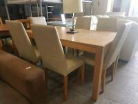Oak extending table and 6 cream leather chairs