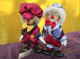 Adorable Porcelain and Fabric Clowns. Sold as a pair.