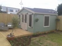 Summerhouse fencing decking and patios
