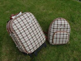 Matching travel trolley and back pack set.