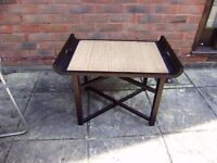 Small contemporary coffee/picnic table, folds flat