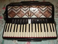 PARROT 120 BASS ACCORDION. 13 treble and 6 bass switches,
