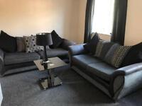 4 seater & 2 seater sofas with a black lamp and black gloss lamp table