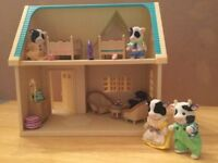 Sylvanian house with accessories and figures.