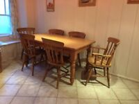 Pine table and six chairs including two Calvers.