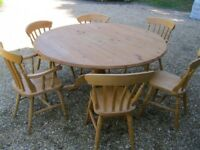 PINE TABLE. 5ft diameter, seats 8. ALSO CHAIRS, CHURCH PEWS & BENCHES & OLD PINE SETTLE FOR SALE