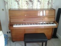 Broadwood modern style piano in polished solid mahogany.