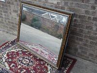 Large bevelled framed mirror