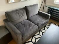 Grey velvet two seater sofa for sale