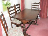 Old Charm (Wood Bros.) Dining Table and Four Chairs