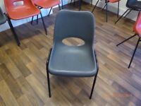 2 plastic chairs with metal frame and stackable