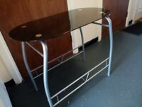Assembled smokey glass table with foot rest