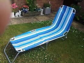 Lightweight fold up sun lounger / camp bed