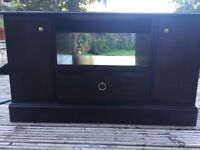 Corner Unit / TV stand / corner side board. It is in an excellent condition. Mahogany dark.