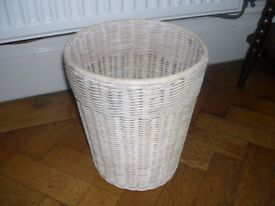 A well made wicker waste paper basket.