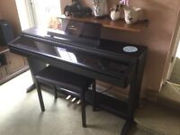 Electric Yamaha Clavinova CLP123 in good condition