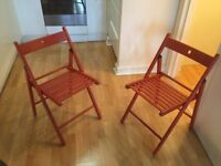 2 red IKEA folding chairs for sale - central London