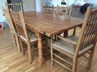 Solid oak refectory style dining table with 4 chairs and 2 carvers