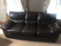 Brown leather sofa and two chairs