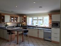 complete fitted kitchen with 20 units and corian worktops