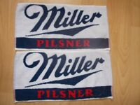 2 Miller lager bar towels Mainly white with blue/red detail.