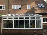 Conservatory roof panels with complete wall of windows for sale