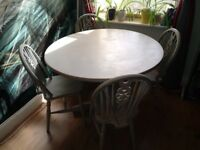 Shabby chic round dinning table & vintagechairs. Sturdy wooden table & chairs hand painted/finished