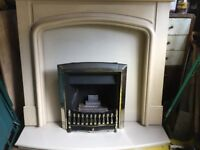 Gas fire with cream marble surround/mantelpiece.